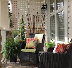 decorating with wicker furniture. decorating the front porch for summer with wicker furniture plants and floral cushions