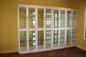 mirror backed glass shelves inside glass front display case in dining room cabinet glass