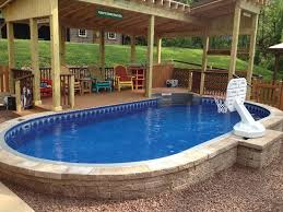oval semiinground pool surrounded by paver stones omg this may be it time to start deck construction love partial above ground s85