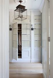 euro week full kitchen: entry built in closet the foyer features cabinet doors with faux ceramic books and