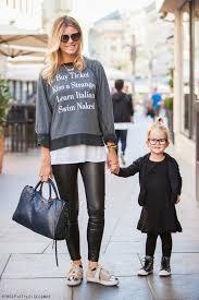 Black, white and grey: Statement sweater, glasses, bun, metallic ...