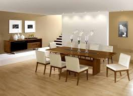 brown wooden long dining table and white upholstery without arms dining chairs as contemporary dining room decor