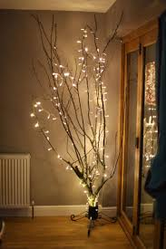 Christmas Branches With Lights Keep The Holiday Glow Alive With These Winter Decor Ideas