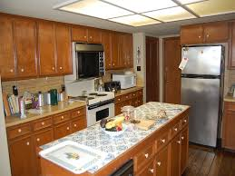 Fluorescent Kitchen Light Fixtures Is Only Used Overhead Kitchen Lighting Correctly The Home Ideas