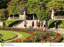 paris france july 07 2017 tourists and parisians relaxing in the luxembourg gardens jardin du luxembourg one of largest public park in paris