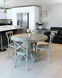 s gray round dining table with leaf