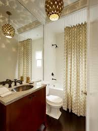 standard curtain lengths with transitional bathroom and contemporary lighting flat panel cabinets gray countertop patterned shower curtain shower above tub
