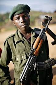 child ier child ier child and  child ier stands at the front line in eastern congo chose to adopt a boy