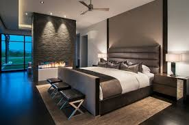 Modern Bedrooms Designs ideas with indoor fireplace in the room stool  seating and wooden board decor