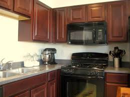Cherry Wood Kitchen Cabinets Picture Of Varnish Cherry Wood Kitchen Cabinet With Black Appliances