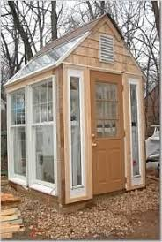 garden greenhouse from recycled salvaged doors and windows building a greenhouse out of old windows by kellyfg greenhouses garden structures forum link