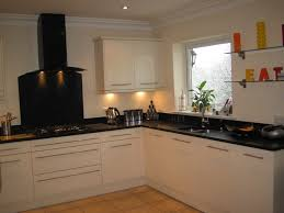 cream kitchen cabinets with black countertops. Kitchen Ideas With Cream Cabinet And Wall Also Black Countertop Cabinets Countertops