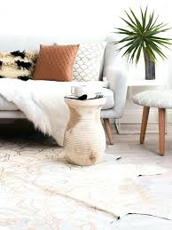 cowhide rugs batik patterned rug from in modern living room on thou swell whole melbourne ikea