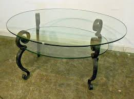 vintage glass top coffee table with black metal legs and shelves for saving small spaces living room design ideas