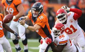 peyton manning broncos. Denver Broncos Quarterback Peyton Manning Lost The Ball After Being Hit By  Kansas City Chiefs Nose Tackle Jaye Howard In First Half. Peyton Manning Broncos