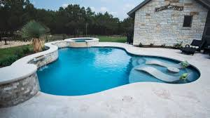 Freeform Pool Designs Freeform Pool With Ledge Loungers And Travertine Decking In