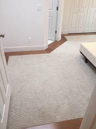 Master Bedroom Flooring Mohawk Dramatic Flair In Hushed Beige Carpet Maple Hardwood Floor