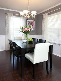 simple wood dining room chairs. chair rail molding divides two-toned walls in this neutral dining room. sheer curtains simple wood room chairs