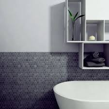 dark hexagon tiles for a bathroom backsplash works well even without border tiles