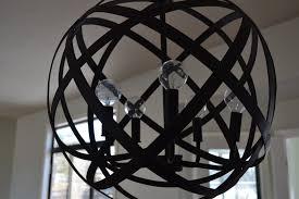 large orb chandelier wood