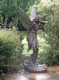 alice in wonderland garden statues for large standing fairy statue garden ornament alice in wonderland