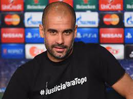 Champions League » News » Guardiola in trouble over dead reporter t-shirt  protest