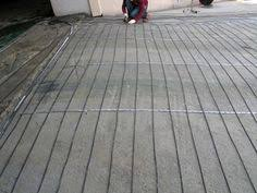 snow melting system installed over old asphalt drive new place Snow Melting Cables for Driveways heatizon hott wire mi cable snow melt heated driveway system