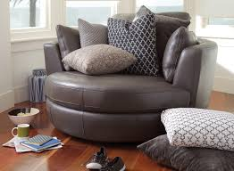most recent cuddler swivel sofa chairs for plush leather sofas round swivel cuddle chair big round