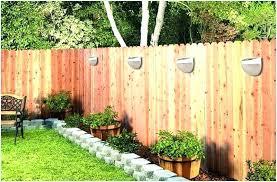 outdoor fence lighting backyard lights a inspire waterproof sensor solar fixtures back outdoor fence lighting brown solar