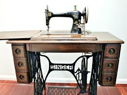 singer sewing machine desk side view of my treadle singer sewing machine cabinet showing decoration on