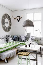 a pallet daybed on casters a pendant metal lamp a wood and aged metal