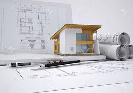 architectural drawings. Scrolls Architectural Drawings And Small House Architect Concept Stock Photo - 28081803