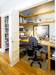 home office in a closet. Elegant Built-in Desk Medium Tone Wood Floor Home Office Photo In San Francisco With A Closet