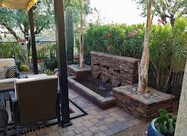 backyard patio waterfall designed with stacked stone style panels in sierra brown