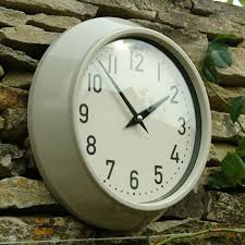 above the large metal weatherproof outdoor clock is available in two colors clay shown and slate it measures 12 6 inches in diameter 45 at willow and
