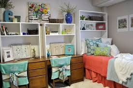 love the use of this shelving unit in place of a headboard to create dorm room