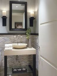 a half bathroom design with brick ceramic tiled wall above the sink