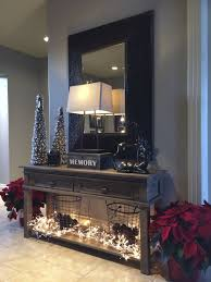 hallway table decor. If Only I Had A Hallway To Do This.Entry Decor Idea: Poinsettias, Christmas Lights, Wire Baskets Filled With Pinecones. Table L