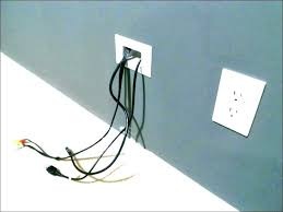 hide electrical cords wall hole cover cord for how to in living room on floor