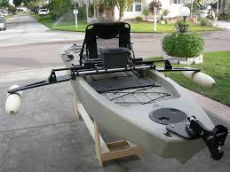 a specialized ilizer system that allows for additional ility when using a kayak for fishing powered acuators allow the operator to lower the arms