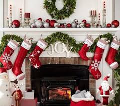 Who wouldn't love to hang out around a fireplace decorated with these  beautiful green and red Christmas decorations? The red stockings and  Christmas balls ...