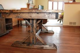 double pedestal old and vintage distressed farmhouse dining table made from reclaimed wood for small dining room spaces ideas
