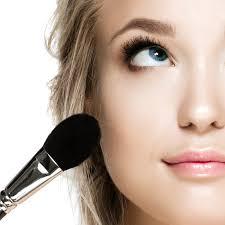 lady applying makeup