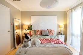 view in gallery small bedroom decorating idea with mismatched bedside tables and a mirror from red images