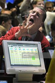 Fran Gleason, an options trader for Schwab, screams out a trade in ...