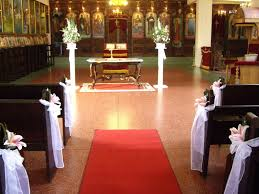 image of wedding pew bows church decorations