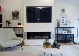 this clean looking three sided electric fireplace burns bright with character and cool factor property brothers season 13 episode 1