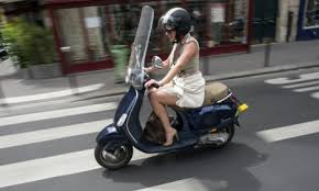 driving a scooter in paris