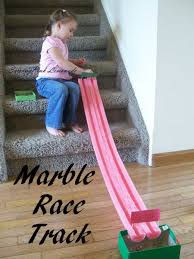 an easy and inexpensive way to make a long track marble run using noodle threads cut them up to size to make it as long