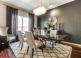 art deco dining room with high ceiling chandelier in dallas tx
